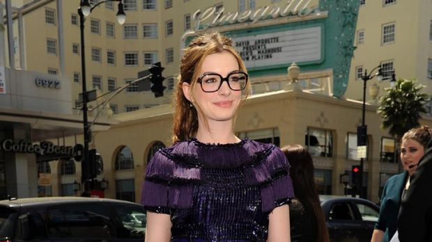 President of the Ponds Institute? ... Anne Hathaway smartens up her look.