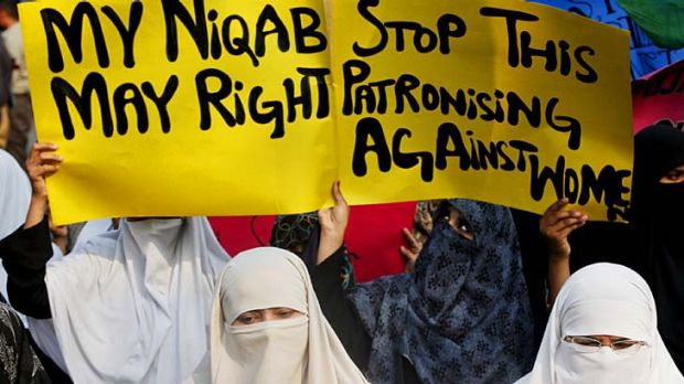 Women in Lahore protest against France's ban on full-face veils.