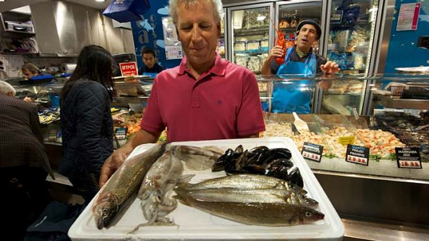 Commercial fisherman John Manias displays sustainable seafood including trout, calamari and mussels  at the Queen ...