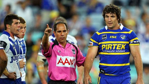 ''He's just a grub. I've been niggled by better'' ... Parramatta captain Nathan Hindmarsh is sent off as Mick Ennis looks on.
