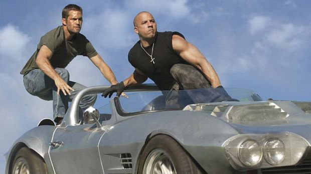You go first: Paul Walker and Vin Diesel return for another stunt-packed joyride in Fast and Furious Five.