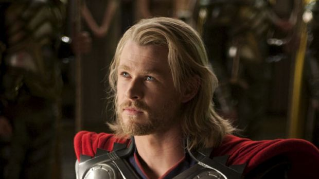 Don't you know who I am?: Chris Hemsworth makes for a convincing comic-book action hero in Kenneth Branagh's <i>Thor</i>.