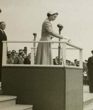 The Queen lights the Perpetual Flame at the Shrine on February 28, 1954.