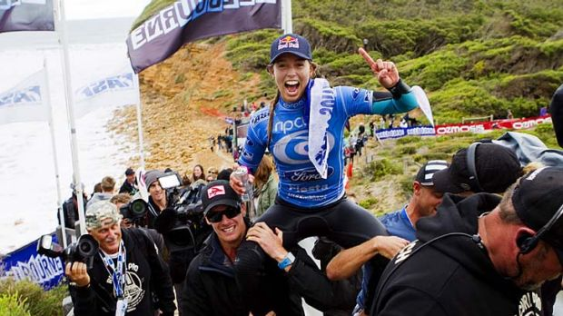 Maiden voyage: Sally Fitzgibbons enjoys the luxury of being chaired up the Bells Beach steps after her first win on the ...