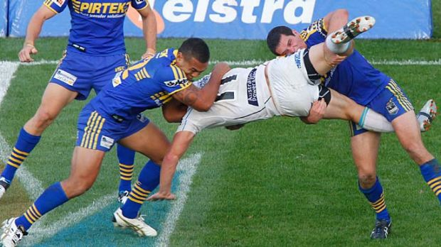 Resilient ... Parramatta's Taniela Lasalo and Daniel Mortimer slam Titans' back-rower Greg Bird to the ground during an ...