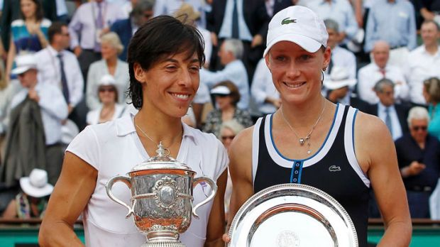 Francesca Schiavone of Italy (left) poses with Stosur during the trophy ceremony after winning the women's final at the ...