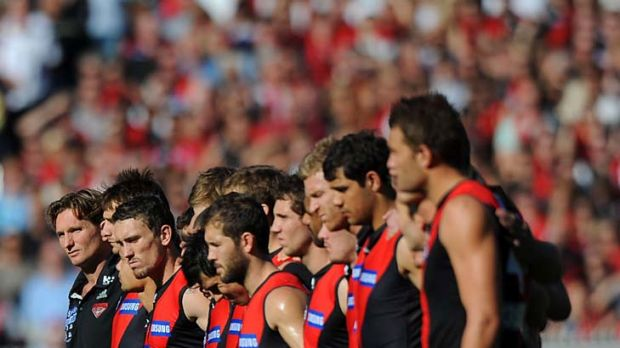 The Essendon team during the minute's silence.
