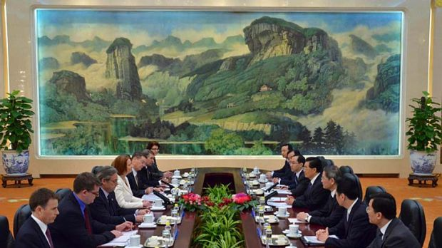 Julia Gillard, fourth from left, and Chinese President Hu Jintao, fourth from right, attend a meeting at the Great Hall ...