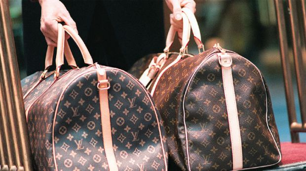 Louis Vuitton bags ... the fake is on the left. China is planning to wipe out its fake goods being produced.