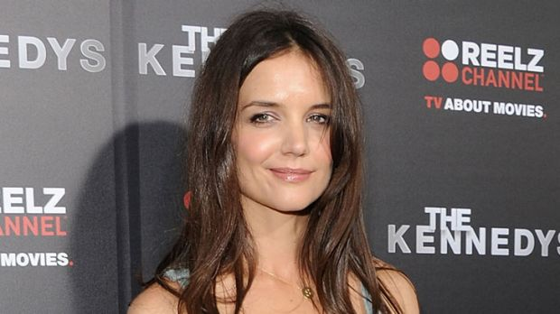 Victory ...  Katie Holmes fights drug addict slur.
