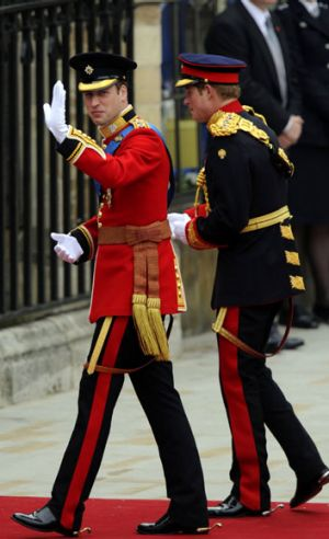 Prince William arrives with his brother Prince Harry at the West Door of Westminster Abbey.