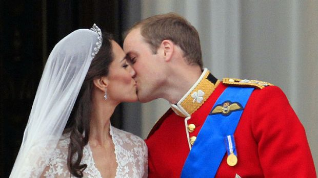 Britain's Prince William kisses his wife Kate, Duchess of Cambridge, on the balcony of Buckingham Palace after the Royal ...
