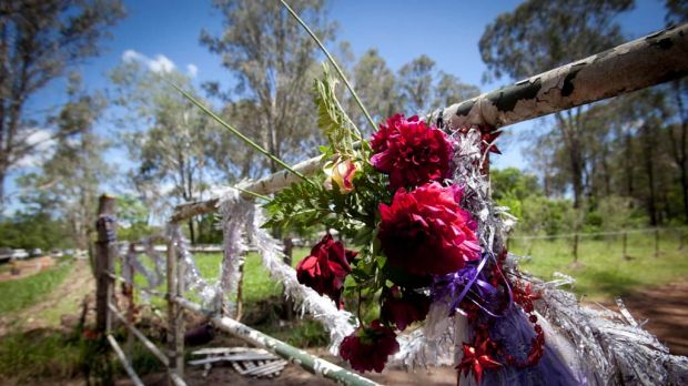 A wreath of flowers on the gate of a Murphy's Creek property where the Shefe family lived.