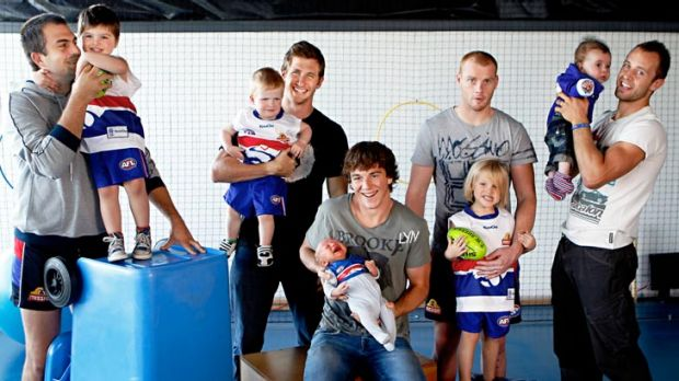 Western Bulldogs players with their young sons, from left, Brian Lake with three-year-old Cohen, Dale Morris with ...