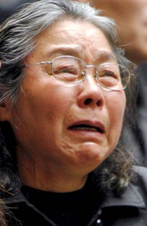 Grief... the Lin family's grandmother at their funeral in 2009.
