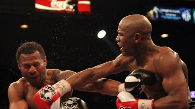 Floyd Mayweather Jr (right) lands a punch during his comfortable decision victory over Shane Mosley in May 2010.