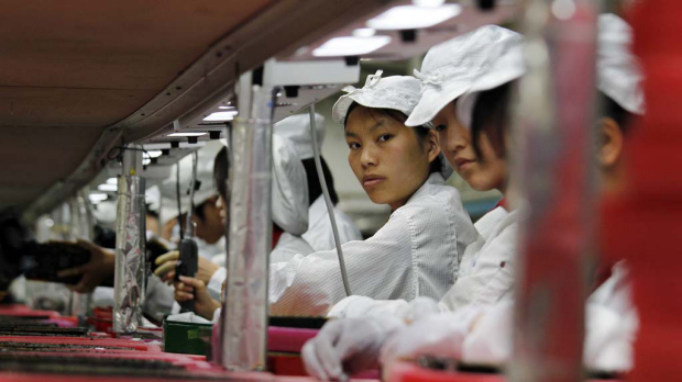 Workers toil at one of Foxconn's factories in China.