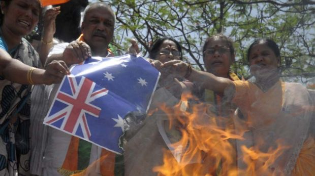 Activists of India's main opposition Hindu-nationalist Bharatiya Janata Party  burn Australia's national flag during a ...