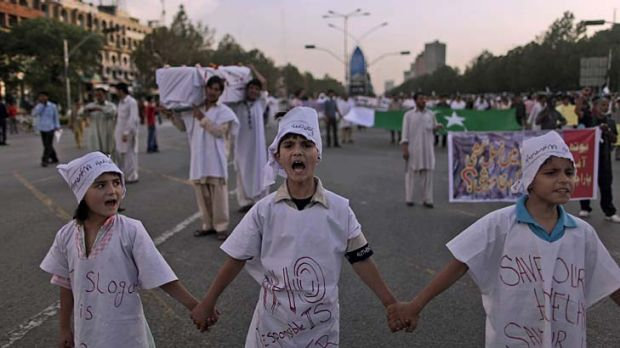 Anger... children chant slogans in a protest again al-Qaeda and the US in Islamabad.