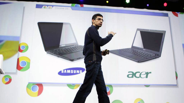 Sundar Pichai, VP of Product Management for Google, displays Acer and Samsung notebooks running on the Chrome operating ...