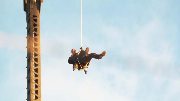 Flying Fox ... Michael Fox abseils off the Harbour Bridge, grinding Sydney transport to a halt.