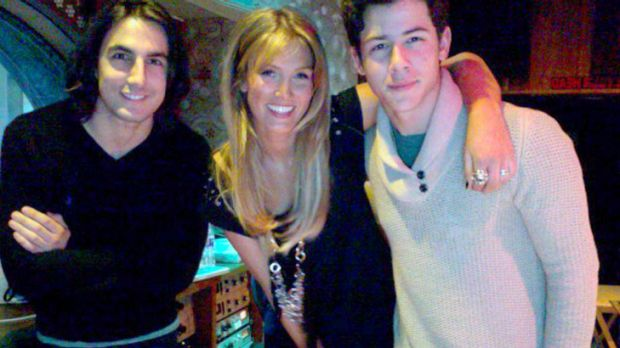 Working relationship ... Greg Garbowsky, Delta Goodrem and Nick Jonas in the studio.