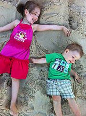 Little angel...Kyla Rogers, pictured with her brother Bronnson, was found dead in a car beside the body of her father, Paul.