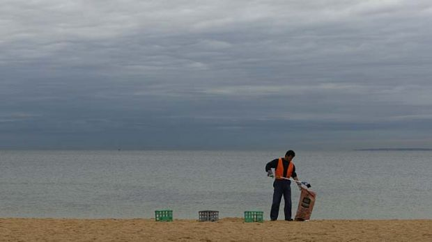 Picking up rubbish on Williamstown beach at 7.30am.