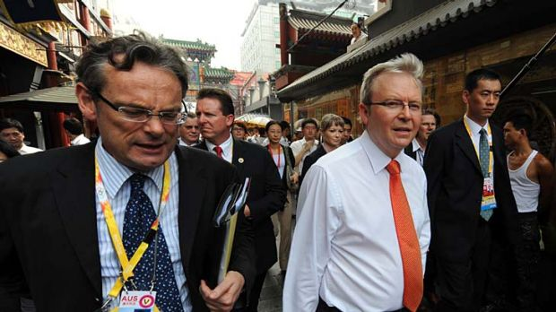 Speaking frankly ... the Australian ambassador to China Geoff Raby (left) walks through central Beijing with the then ...