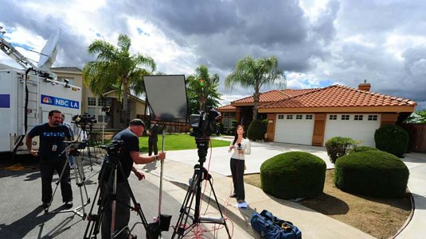 Under siege ... media wait outside the home of Mildred Patricia Baena.
