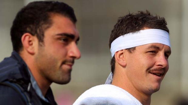 Let's get physical ... Blues enforcer Greg Bird shows off his retro look alongside teammate Tim Mannah at training on ...