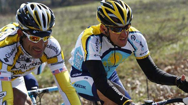 George Hincapie (left) rides alongside Lance Armstrong during the 2009 Milan-San Remo cycling classic.