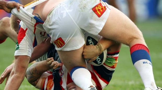 If you dish it out ... Jared Waerea-Hargreaves is slammed into the turf by Newcastle forward Dan Tolar. The hulking ...