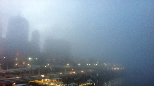 A view of the foggy city from the Victoria Bridge.