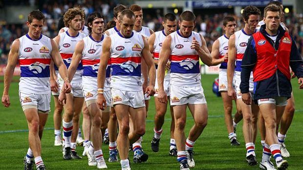 Dog of a day: The Bulldogs, tails between their legs, traipse off after their flogging by the Eagles.