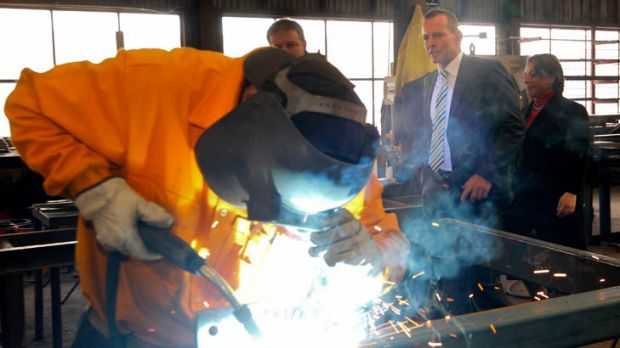 Feeling the heat ... Tony Abbott at a factory in Queanbeyan this week.
