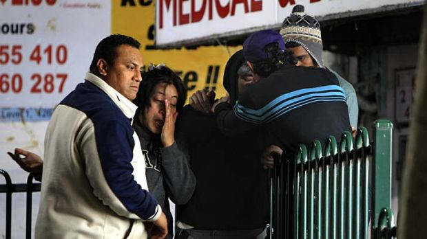 Stabbed to death ... Brandon Faananu Siaa's family and friends comfort each other at Bankstown train station last night.