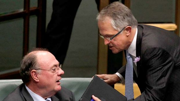 My point is ... Malcolm Turnbull has a word with the Opposition Whip Warren Entsch during question time in Canberra ...
