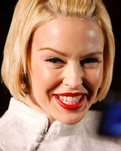 Kylie Minogue talks to the media during a event in Shanghai April 11, 2007.