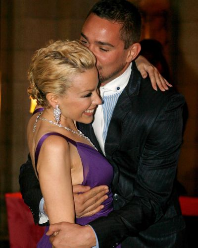 """Kylie Minogue  is embraced by stylist William Baker as they attend the inauguration party of """"Kylie: The Exhibition""""  in ..."""
