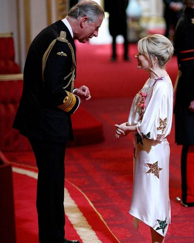 Kylie Minogue at Buckingham Palace after receiving her OBE from Britain's Prince of Wales. July 2008.