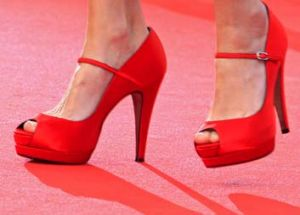 The shoes of actress Frederique Bel as she arrives on the red carpet for the screening of Habemus Papam (We Have A Pope) ...