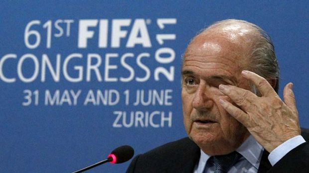 Sepp Blatter addresses a news conference after being re-elected for a fourth term.