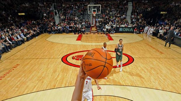 Back dunking: Andrew Bogut in action this year for the Milwaukee Bucks and an injury nightmare.