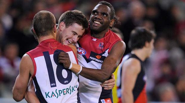 We're laughing: Debutant Jeremy Howe, Brad Green and Liam Jurrah after Melbourne's 33-point win.