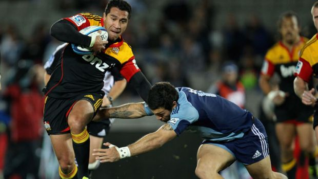 Mils Muliaina of the Chiefs is tackled by the Blues' Rene Ranger.