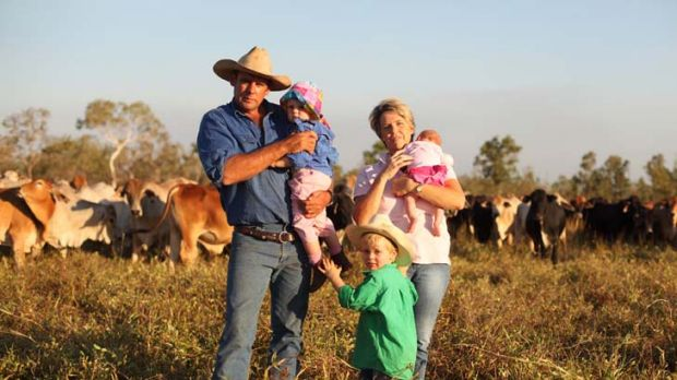 Surviving on their own ... Chris and Marie Muldoon with Jock, 3, Lizzie, 2, and baby Isabella, on their property south ...