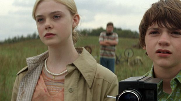 Elle Fanning and Joel Courtney in Super 8.