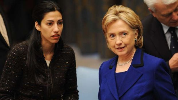 Pregnant ... Huma Abedin, left, with Hillary Clinton.