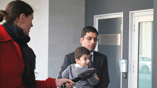 Royal Perth Hospital endocrinologist Suhail Ahmed Khan Durani, 35, outside court with his son following his guilty verdict.